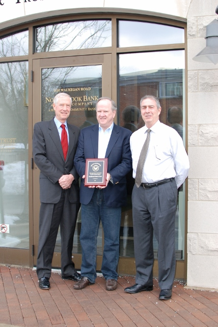 Michael Nugent (center) from the Glenbrook High School Foundation presenting a plaque to Richard Rushkewicz and David Masters from Northbrook Bank & Trust. The Foundation thanks NB&T for their generous contribution to the Foundation's scholarship program.